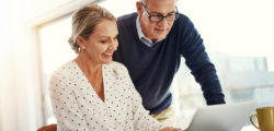 Woman and man looking at dental insurance plans online
