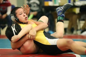 Adam Rivers of Scammon Bay battles Charles Smith of BRHS Jr. High during the GJE Wrestling Invitational. Rivers won taking gold in the 133 lbs. division.