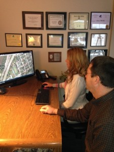 Private Investigator viewing aerial surveillance