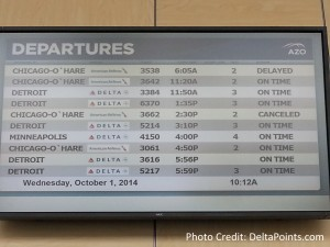 departure sign azo airport delta points blog
