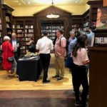Photo from the book launch of Death of a Butterfly: Mental Health Court Diaries from September 11, 2019 at Ben McNally Books. People mingle in the store before the launch begins.