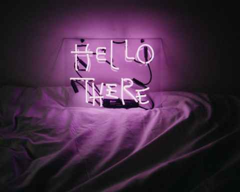 purple love me love me neon light signage