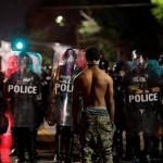 black man facing down police
