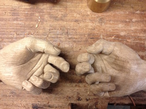 Konstantinos Papadakis's wood carved resident-to-resident friendship - hands reaching towards each other