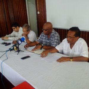 Second from left: President of GAWU, Komal Chand; NAACIE President, Kenneth Joseph and GAWU General Secretary, Seepaul Narine at the news conference held on January 25, 2016.