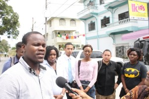 Clayon Halley of Youths for Local Government briefing the media in the presence of other candidates.