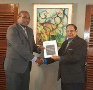 FLASH BACK: Head of the steering committee on constitutional reform, Nigel Hughes (left) delivering the report to Prime Minister Moses Nagamootoo.