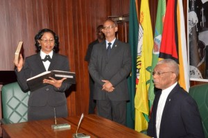 Justice Yonette Cummings-Edwards, Chief Justice (Ag) takes her Oath as a Member of the Judicial Service Commission, before His Excellency, President David Granger, at the Ministry of the Presidency Wednesday morning.