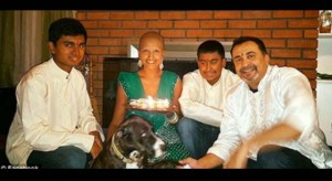 Team effort: Deokaran is pictured here with her two sons and her boyfriend.
