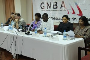 Chairman of the Board of Directors of the Guyana National Broadcasting Authority, Leonard Craig (white long sleeved shirt) flanked by other members of the Board at a news conference. Mr. Tony Vieria is second from left of Craig.