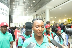 Team Manager Keisa Burnette speaking with reporters at New York's JFK Airport.