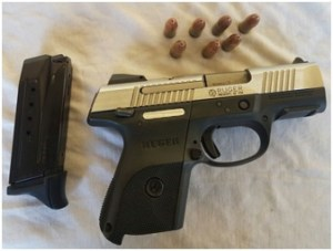 """The gun and ammunition that were allegedly found in possession of Eon """"Killa"""" Warde at his home at Central Amelia's Warde, Linden."""