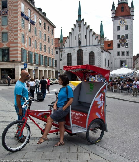 Marienplatz. A velorikshaw in from of the Old Town Hall