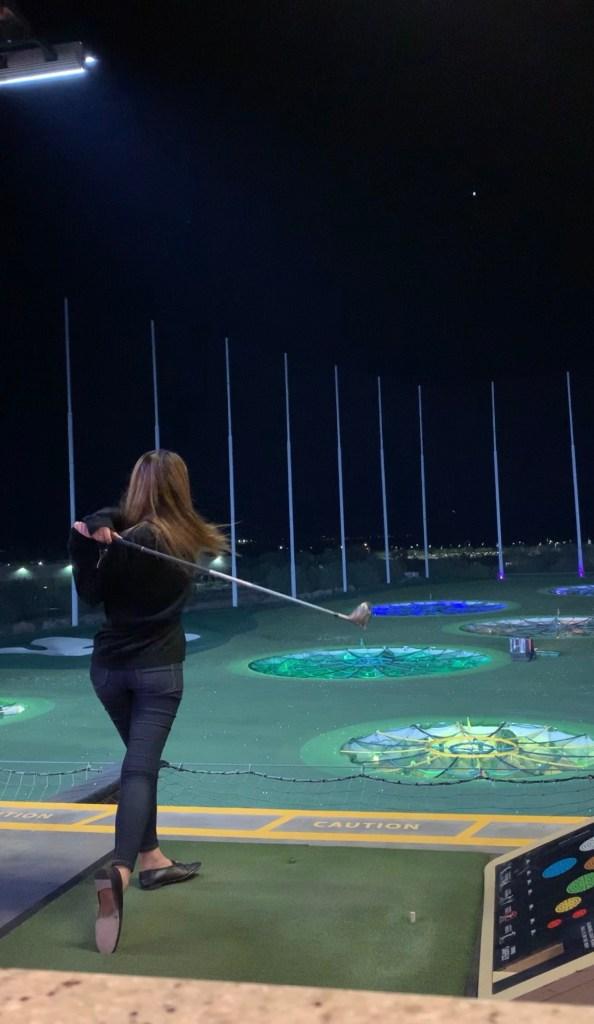 Demi Bang playing golf at TopGolf.