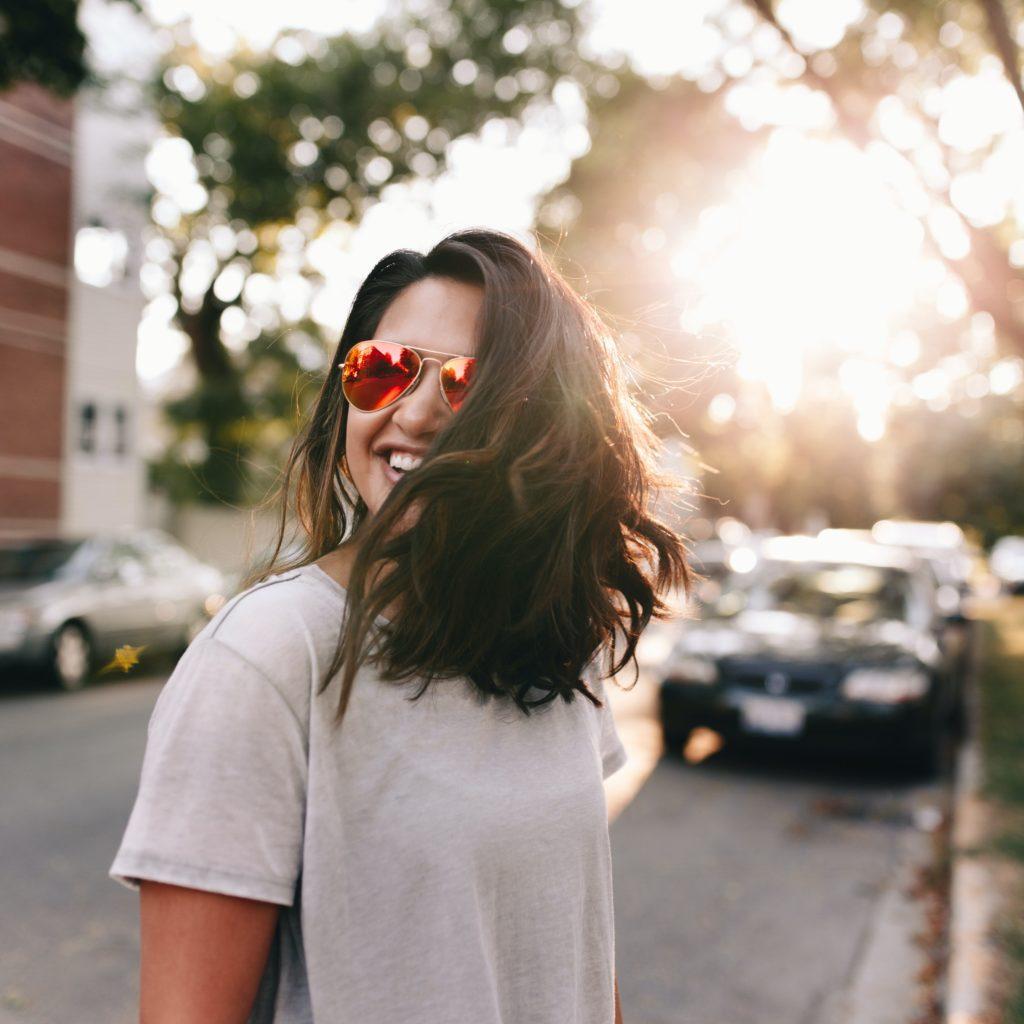 woman wearing white T-shirt smiling