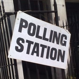 UK polling station sign on a railing