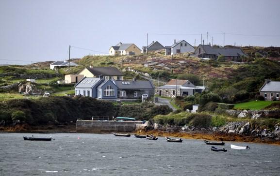 Piers - Currachs bobbing in the bay at Errislannan near Clifden in Connemara
