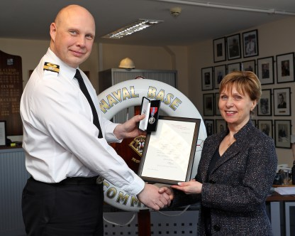Anne Cromar Receives Imperial Service Medal from Naval Base Commander Commodore Gayfer