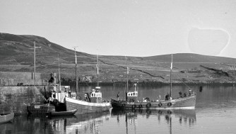 Piers - fishing boats at the pier in Cleggan
