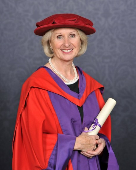 Rita with honorary doctorate scroll