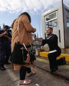 HMS Bangor Returns Pictured here AB Mine Warfare Joshua Betman proposes to Hazel Staunton HMS Bangor, one of the Royal Navy's seven Sandown-class mine countermeasures ships, has left Bahrain after three years of Middle East heat and returned back to her home in Faslane, Scotland. Families lined the jetty to welcome the Faslane based MCMV home after three years in Bahrain. Over the past three years the ships have surveyed across the Gulf, visited 15 different countries, entertained countless VIPs and once in their home ports, will have travelled more than 40,000 nautical miles each. *** Local Caption *** consent held