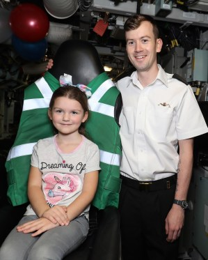 Ambush Families Day Pictured here: Paighton read 6 years old with Petty Officer Phillip Read ROYAL NAVY Submariners recently welcomed their loved-ones to their workplace when HMS Ambush held a families' day at HM Naval Base Clyde. The Astute-class vessel – which is the second of three currently in service with the Royal Navy – opened her hatches on Friday, September 21. *** Local Caption *** Consent held