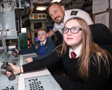 Ambush Families Day Pictured here; Phoebe Tarr(13), Petty officer Chris Tarr (43) and Leon Tarr (11) ROYAL NAVY Submariners recently welcomed their loved-ones to their workplace when HMS Ambush held a families' day at HM Naval Base Clyde. The Astute-class vessel – which is the second of three currently in service with the Royal Navy – opened her hatches on Friday, September 21. *** Local Caption *** consent held