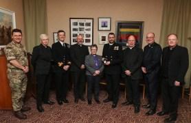 Commodore Doull presenting a good conduct medal to Reverand Mark Dalton in the comachio room HMS NEPTUNE Wardroom