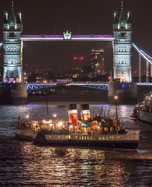 PS Waverley slips under London Bridge and past HMS Belfast 2