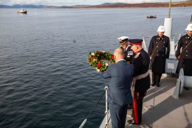 HMS Royal Oak 80 years remembrance week. NDG divers recovering a White Ensign and flying and stowing a new White Ensign. Royal Oak 80 Survey team was recording these events and poppy planting and memorial serivce at sea, Scapa Flow.