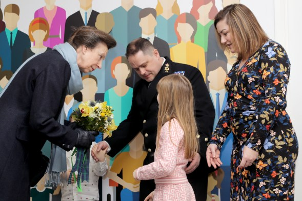 Pictured: HRH The Princess Royal is presented with some flowers from Lillie (7) and Ross (4) Wood. HER Royal Highness The Princess Royal opened a renovated facility at the heart of Helensburgh in Argyll and Bute today (January 24). The Drumfork Community Centre in Helensburgh's Churchill Square has undergone £2M of work, with much of the funding coming from the Royal Navy and Royal Marines Charity (RNRMC). The new centre will be a hub for military personnel, their families and members of the wider community.