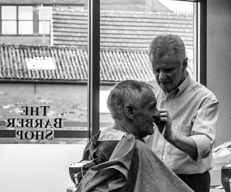 Barber - John McCann cuts the hair of former professional sprinter Pat MCafferty.
