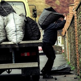Coalman delivering concessionary coal to a retired miner at Llanhilleth South Wales UK