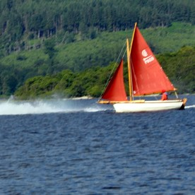 Fair 4 Yacht and jet ski on Loch Lomond
