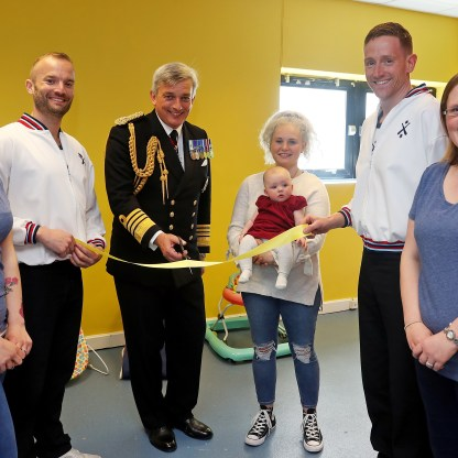 """Pictured: Admiral Sir Philip Jones KCB, ADC, the First Sea Lord opens HMS Neptune Creche. From left to right Sophie Love, POPT Robinson, Admiral Sir Philip Jones KCB, ADC, the First Sea Lord, Jami Owen and daughter Elsie Hildreth, LPT Duffy and Kay whittle. GOLDEN ANNIVERSARY FOR SCOTLAND'S LARGEST MILITARY SITE MILITARY and civilian personnel at Scotland's largest military base came together today (May 10) to celebrate the 50th anniversary of HMS Neptune, the shore establishment which evolved into HM Naval Base Clyde. Admiral Sir Philip Jones KCB, ADC, the First Sea Lord, reviewed military personnel at the site during ceremonial divisions which featured submariners, sailors and Royal Marines from the Base. """"I'm really pleased to attend this event and to share in the celebrations as we mark an important milestone in the life of HMS Neptune,"""" said the First Sea Lord. """"I'd like to thank all those who work at Her Majesty's Naval Base Clyde, whatever their role, for everything they have done and continue to do in support of this vital endeavour to ensure our nation's security."""""""