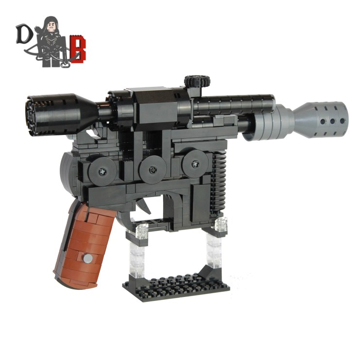 """This listing is for all the parts to build your very own Dl-44 Heavy Blaster Pistol with stand inspired by Star Wars, it comes unassembled and upon purchase I will email you a PDF copy of the instructions and send out all the pieces necessary to build it as pictured. This is a 1:1 replica of Han's Blaster and measures 29cm in length and is 18cm tall on the stand. Made using genuine LEGO parts only. Each Blaster is carefully packaged into a re-sealable bag and shipped in a bubble lined envelope for extra protection. """"LEGO® is a trademark of the LEGO Group of companies. The LEGO Group does not sponsor, authorise or endorse the modified/customised product(s) shown nor does it accept responsibility in any way, shape or form for any unforeseen and/pr adverse consequences following from such customisation/modification.""""*Not associated with Lucas film/Star Wars/Disney."""