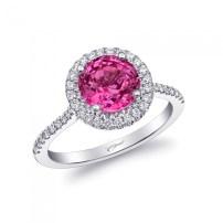 Vivid pink sapphire and diamond halo ring