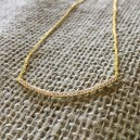 Gold-plated sterling and CZ curved bar necklace $39