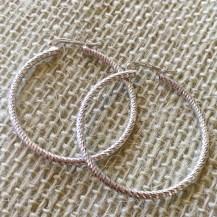 Sterling diamond cut hoop earrings $35