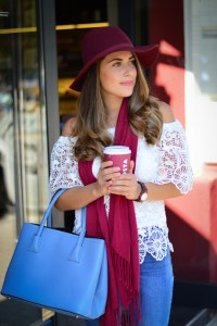Bulgarian Fashion Blogger Denina Martin dressed in blue, wine red and white at Costa Cafe