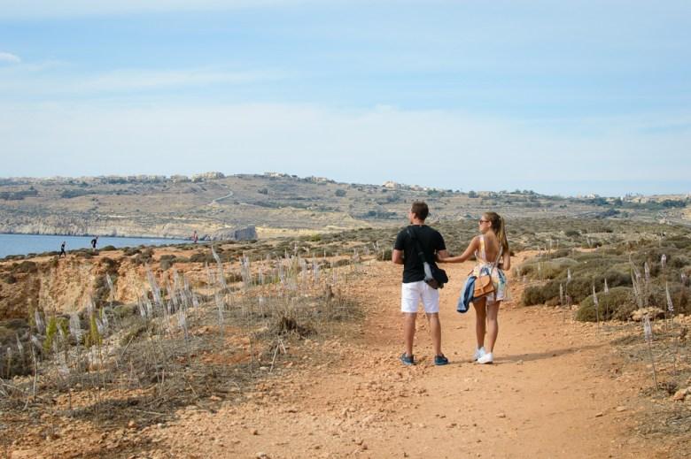 Couple exploring Comino Island of Malta