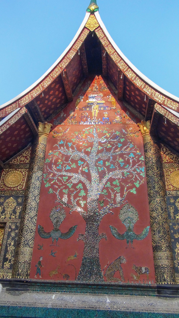 The rear gable of the sim at Wat Xieng Thong is decorated with a glass mosaic depicting the tree of life.