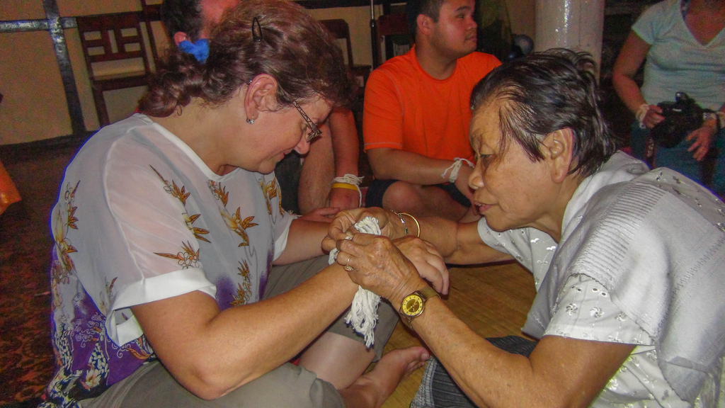 The elders tied a string around each wrist while reciting a greeting and blessing.