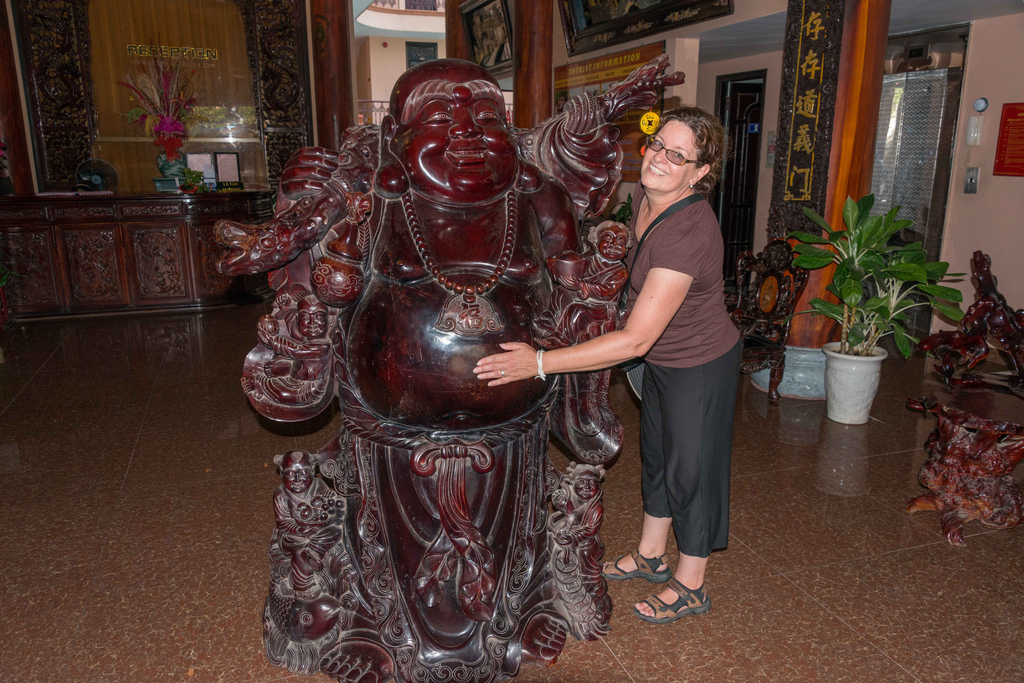 Denise posing with the other Happy Buddha.