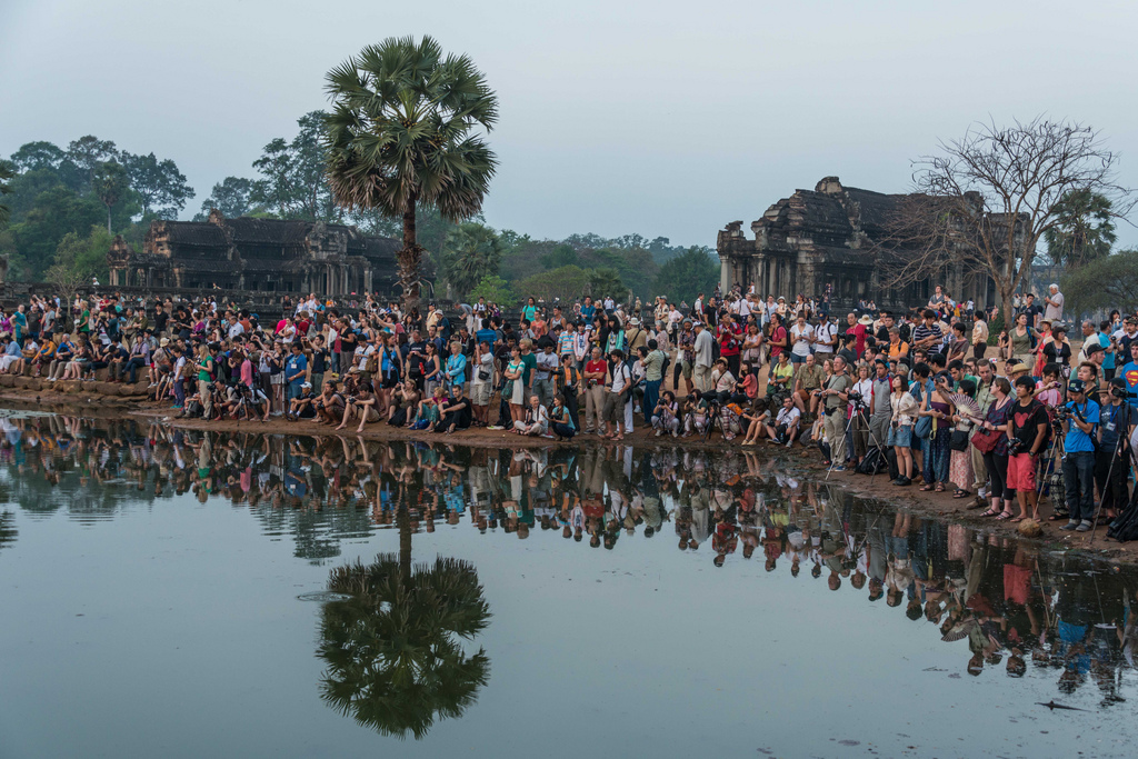 Sure, the sun is rising in a haze behind the great ruins. But THIS is what sunrise at Angkor Wat actually looks like.