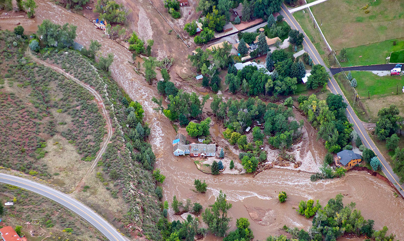 Phyllis and John's house after the September 2013 flood. The river took a different course (it now mainly flows on the north side), eroded the soil under their house, and lifted it off its foundation. Their house AND their property has been condemned as it is now in the flood zone (Photo by John Wark, Special to The Denver Post).