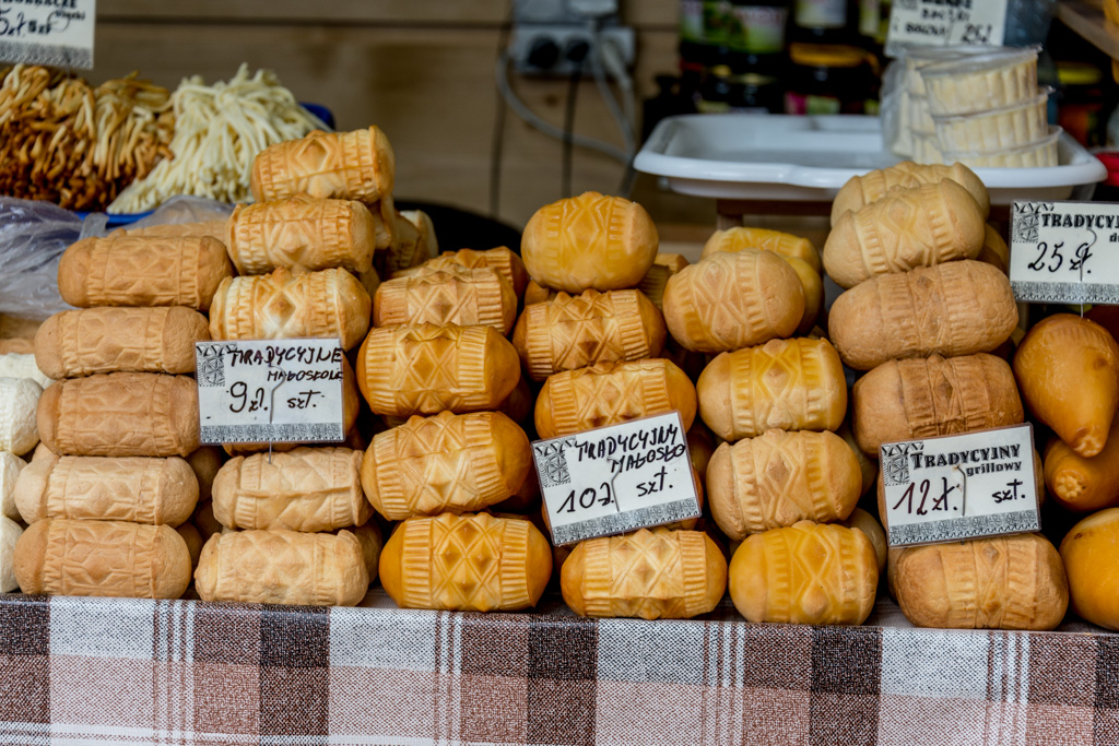 A display of smoked cheeses; a specialty of the region.
