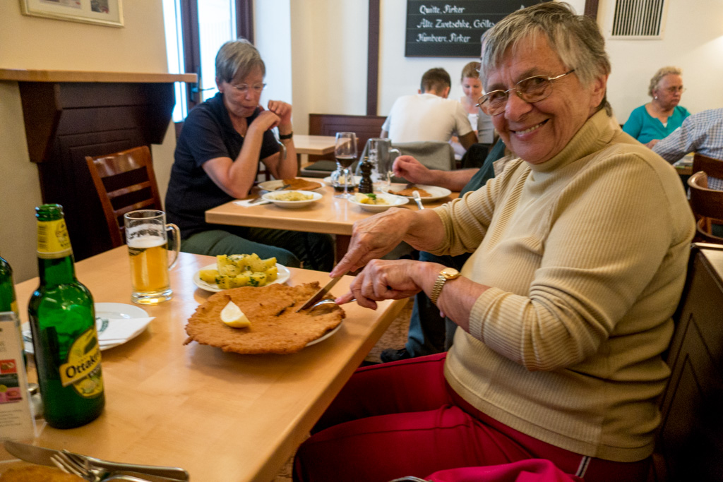 Helen digs into her schnitzel at the famous Figlmüller restaurant.