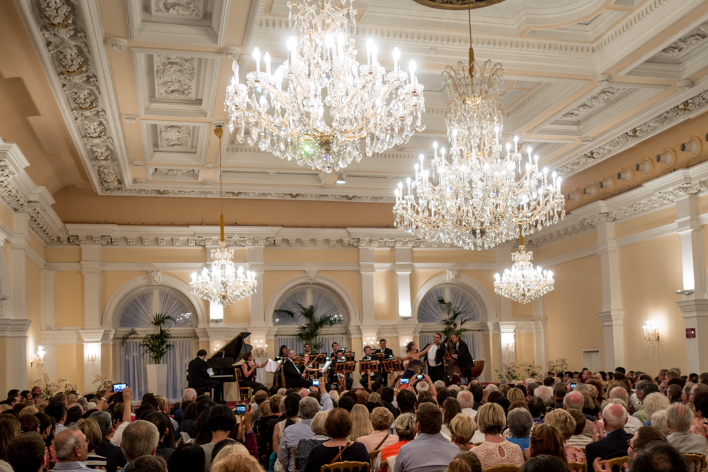 Of course, you must go to a show in one of the period concert halls to listen to a performance of Strauss, Mozart, and other illustrious composers.