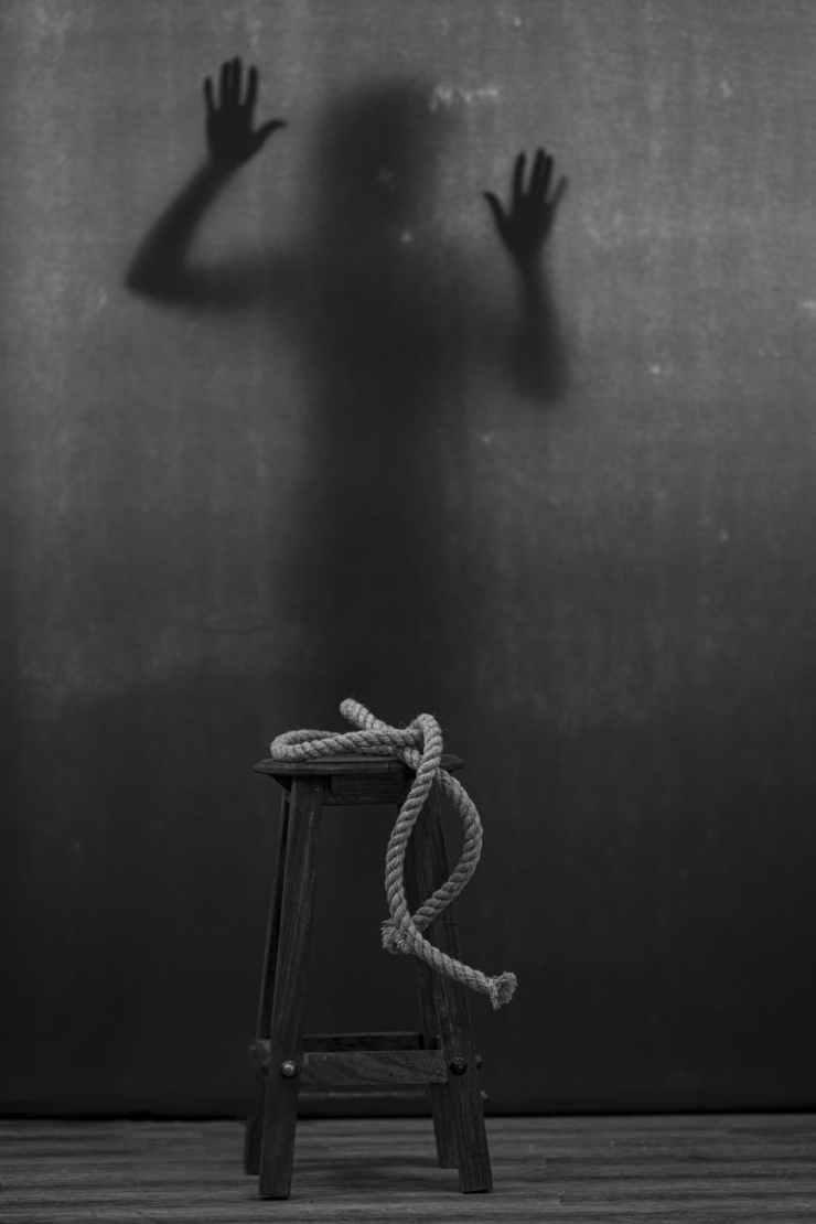mysterious shadow behind dark backdrop